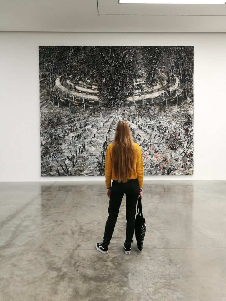 Cristina Ricci in front of Anselm Kiefer's painting at the White Cube